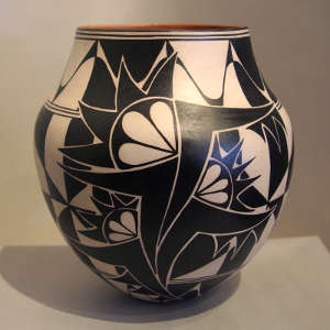 Black and white geometric designs on a polychrome jar