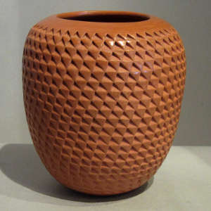 Red jar with corrugated surface