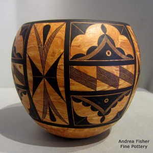 Black geometric design on a marbleized clay jar