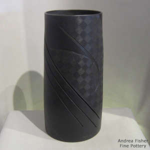 Lightly carved, sgraffito and painted geometric design on a black on black on black cylinder