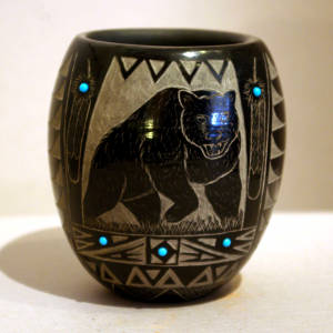 Sgraffito bear and Sioux geometric designs decorate a polished black bowl with inlaid turquoise