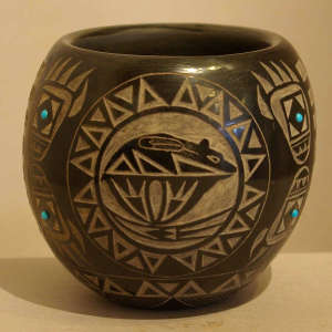 Sgraffito bear, bear claw and geometric design plus inlaid faux turquoise on a black jar