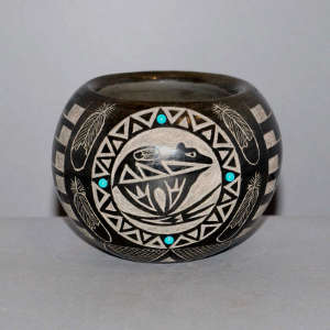 Sgraffito Sioux bear, feather and geometric design on a black jar with faux turquoise inlays