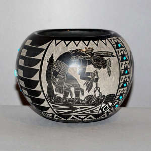 Sgraffito Sioux design and inlaid stones on a black jar