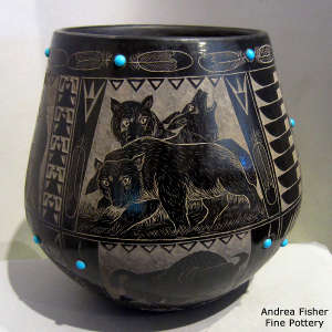 Sgraffito wildlife, nature and Sioux design on a black jar with inlaid stones