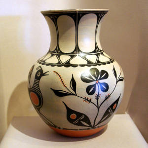 Bird, flower and geometric designs on a large polychrome jar