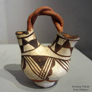 Twisted handle and geometric designs on a polychrome wedding vase