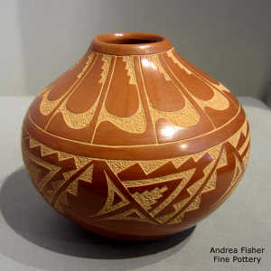 Sgraffito feather, kiva step and geometric design on a red jar