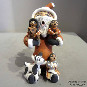Three children and two puppies on a Santa Claus storyteller