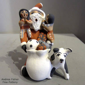 Two children and a puppy on a Santa Claus storyteller