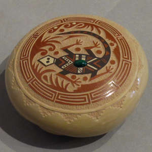 Sgraffito and painted lizard and geometric designs on a polychrome seedpot