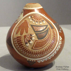 Sgraffito corn, feather and geometric designs decorate a polychrome seedpot