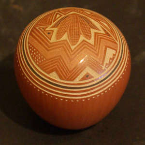 Sgraffito corn and geometric design on a red seedpot
