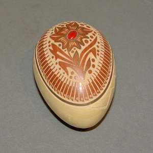 Sgraffito feather and flower design with inlaid coral on an egg-shaped polychrome seedpot