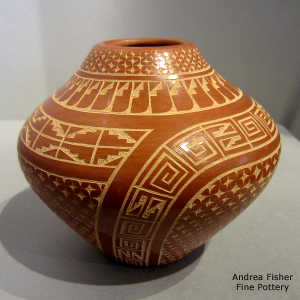 Sgraffito feather, spiral, kiva step and geometric design on a polished red jar