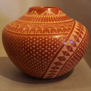 Sgraffito kiva step, feather and geometric design on a polished red jar