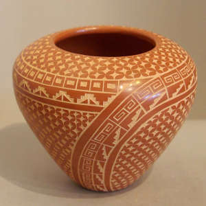 Sgraffito kiva step and geometric design on a polished red jar
