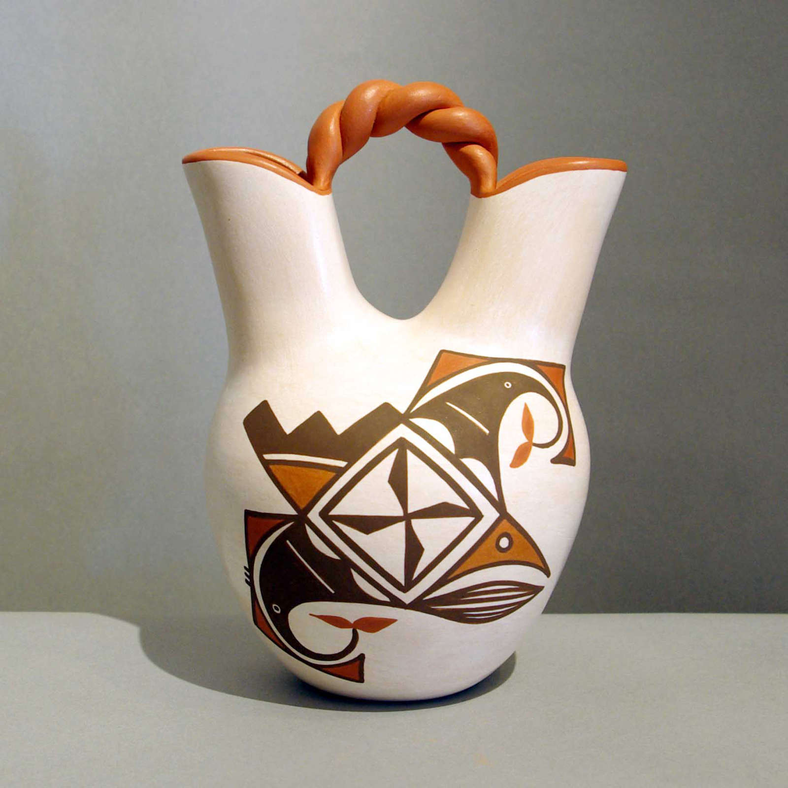 Gladys paquin laguna pueblo potters bird element medallion and geometric design on a polychrome wedding vase with a twisted handle reviewsmspy