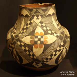 Fine line, medallion and geometric design on a polychrome jar by an unknown Laguna Pueblo potter