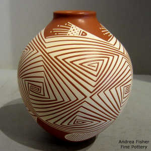 White geometric design on a red jar