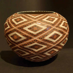Geometric designs decorate a polychrome graphite jar