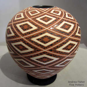 A diamond geometric design on a polychrome jar