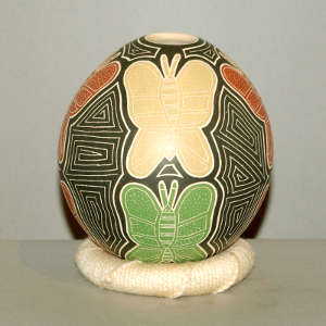 Sgraffito and painted butterflies and geometric design on a polychrome jar