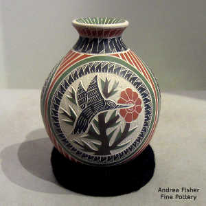 Lightly carved, sgraffito and painted hummingbird, floral and geometric design on a polychrome jar