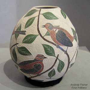 Sgraffito and painted bird, branch and leaf design on a polychrome jar