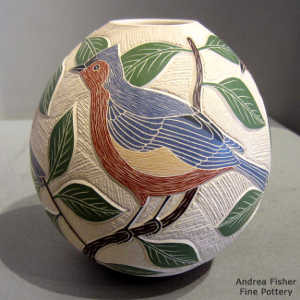 Sgraffito and painted bird, leaf, branch and geometric design on a polychrome jar