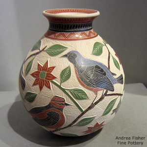 Sgraffito and painted bird, branch and geometric design on a polychrome jar