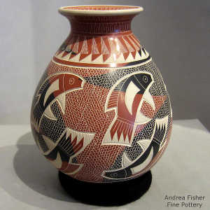 Sgraffito and painted fish, mesh and geometric design on a polychrome jar