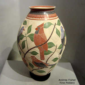 Sgraffito and painted branch, bird and geometric design on a polychrome jar
