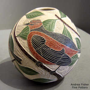 Sgraffito and painted branch, leaf, bird and geometric design on a polychrome jar