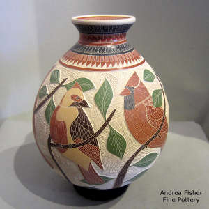 Lightly carved, sgraffito and painted branch, bird and geometric design on a polychrome jar