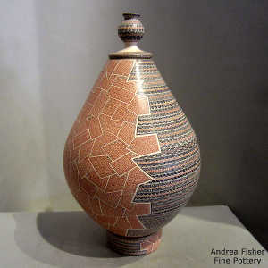 Matching stand and lid for a polychrome jar with sgraffito and painted geometric design