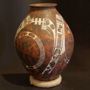 White Paquime designs on a brown and black marbled clay jar