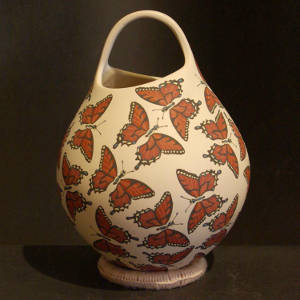 Butterfly design on a polychrome jar
