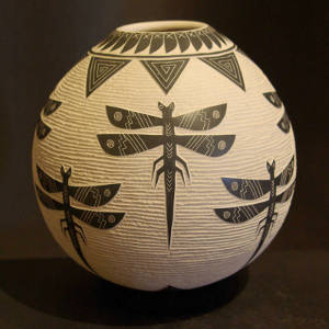 Sgraffito dragonflies and geometrics designs on a black jar