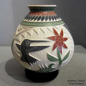 Sgraffito and painted flower, serpent, hummingbird and geometric design on a polychrome jar