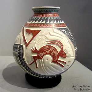 Lightly carved, sgraffito and painted rabbit, roadrunner and geometric design on a polychrome jar