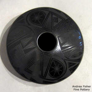 Paquime shard and geometric design on a black on black flying saucer jar