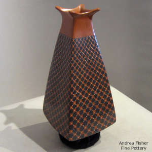 Geometric design on a polychrome pyramid jar with a flared square opening