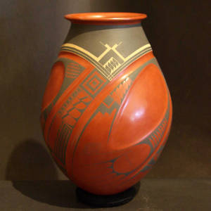 Paquime geometric designs decorate a lightly carved polychrome jar