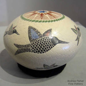 Sgraffito and painted hummingbird and geometric designs on a polychrome seedpot