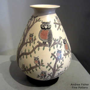 Sgraffito and painted owl and branch motif on a polychrome jar