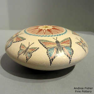 Sgraffito and painted butterfly and geometric design on a polychrome seed pot