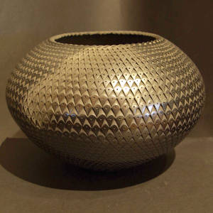 Textured graphite surface on a black jar