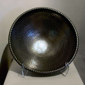 Corrugated surface on a large polished black bowl