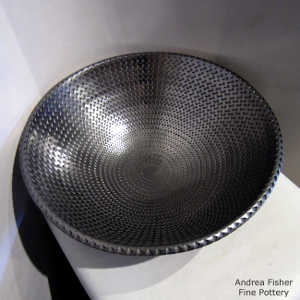 Corrugated surface inside and out on a polished black bowl
